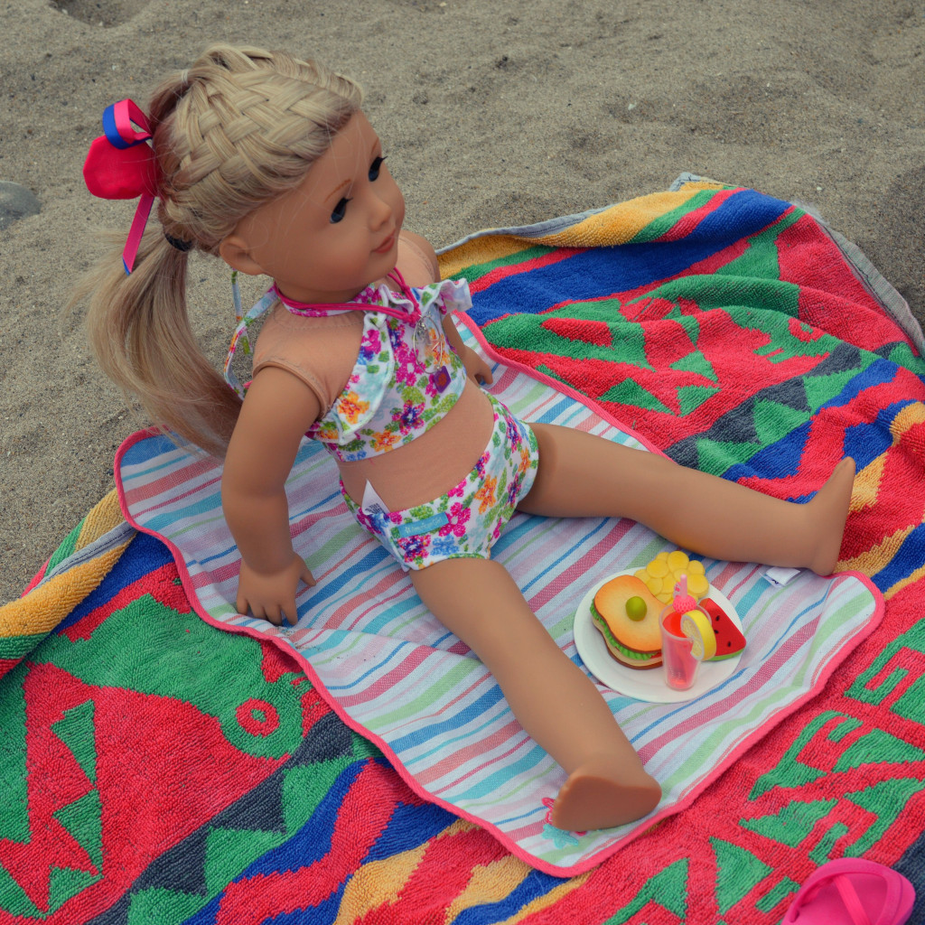 american girl doll on the beach