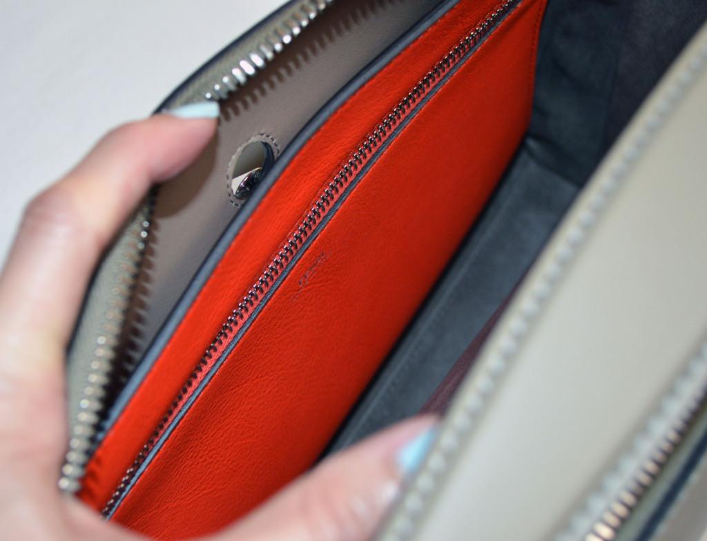 fendi dot com clutch attached inside