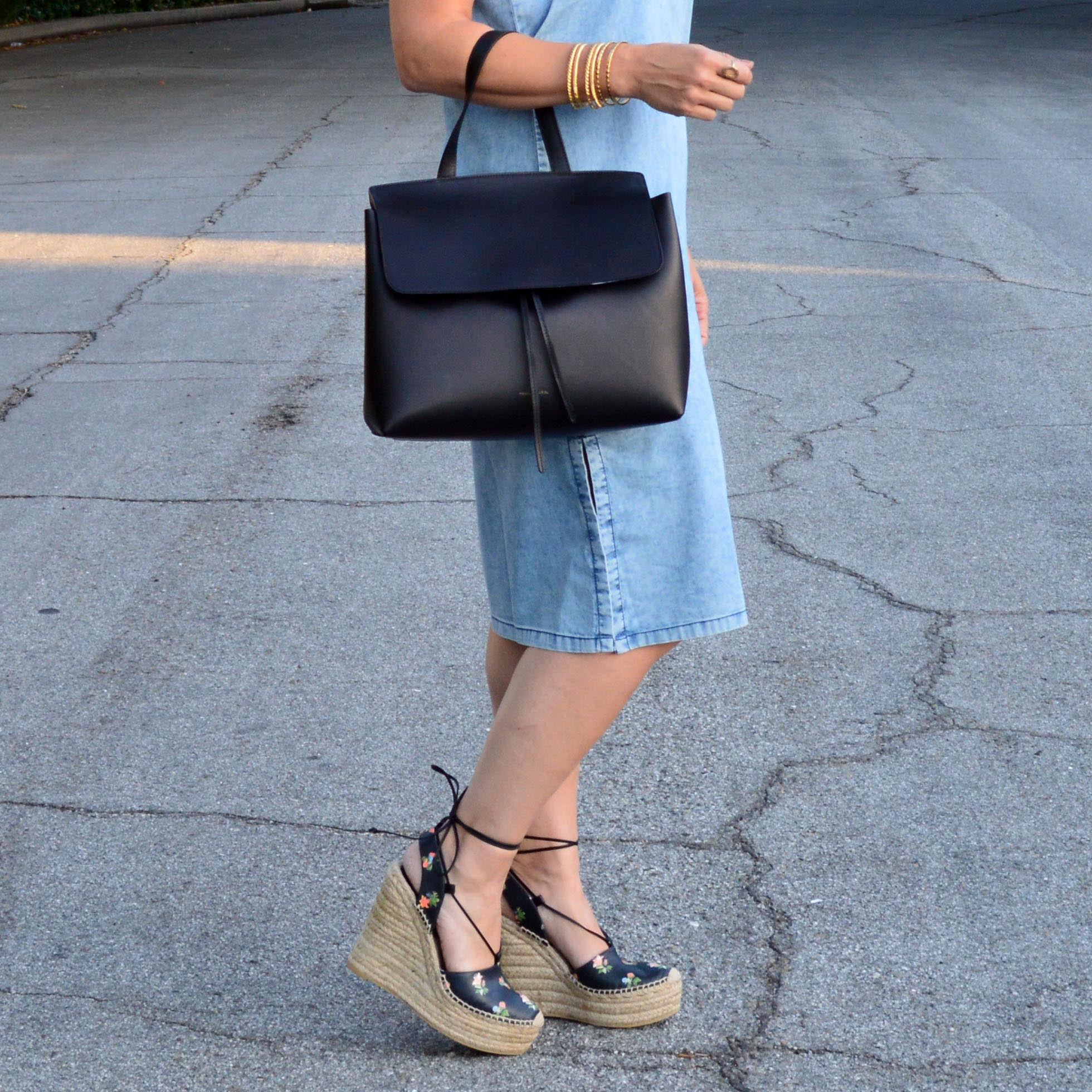 lady bag and denim dress